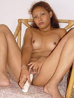 Horny asian teen likes pussey dildo